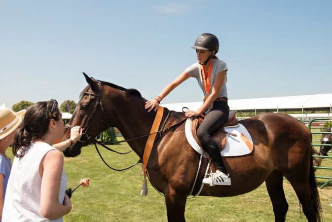 Jessica Springsteen helped to showcase adoptable rescue horses at the seventh annual ASPCA Adoption & Animal Welfare Day at the Hampton Classic Horse Show on August 28th. (Courtesy of the ASPCA)
