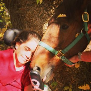 Zara and her favorite therapy horse, Snoopy. ©Janice Friddle
