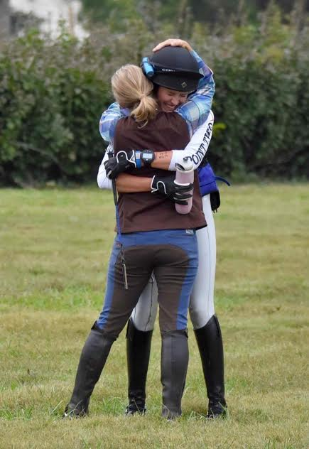 A huge embrace at the end of the course. Photo by JJ Sillman.